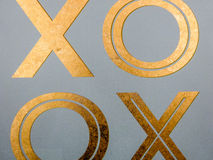 Golden xoxo letters on canvas  board Royalty Free Stock Image