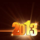 Golden year 2013 with shining rays, brown background Royalty Free Stock Photo