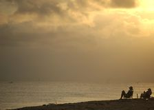 The Golden Years III. Couple on beach at sunset royalty free stock image