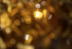 Artistic style bokeh light defocused abstract texture background. Golden yellow bokeh light defocused abstract  background  with copy space Royalty Free Stock Photography