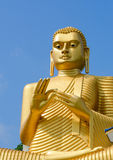 Golden yellow Buddha statue Stock Image