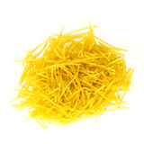 Golden yellow dry soup noodles isolated on white background. Stock Photo