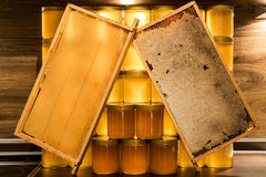 Golden yellow honey glass jar on wooden board Closeup Copy space comp frame empty and filled with bee logo textspace Stock Images