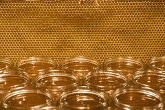Golden yellow honey in glass jar on wooden board Closeup Copy space comp frame empty textspace Stock Photo