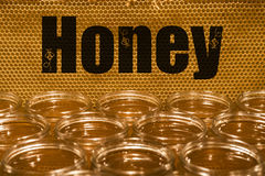 Golden yellow honey in glass jar on wooden board Closeup Copy space comp frame empty textspace Royalty Free Stock Photography