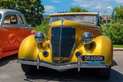 Golden yellow hot rod car Royalty Free Stock Image