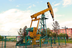 Golden yellow Oil pump of crude oilwell rig Royalty Free Stock Image