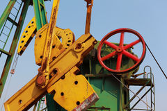 Golden yellow Oil pump of crude oilwell rig Royalty Free Stock Photo
