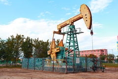 Golden yellow Oil pump of crude oilwell rig Royalty Free Stock Images