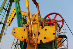 Golden yellow Oil pump of crude oilwell rig Royalty Free Stock Photos