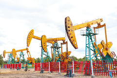 Golden yellow Oil pump of crude oilwell rig Stock Image