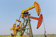 Golden yellow and orange Oil pump of crude oilwell rig Stock Photography