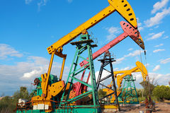 Golden yellow and pink Oil pump of crude oilwell rig Royalty Free Stock Photos