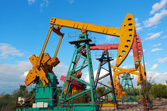 Golden yellow and pink Oil pump of crude oilwell rig Stock Photography