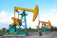 Golden yellow and pink Oil pump of crude oilwell rig Royalty Free Stock Photo