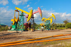 Golden yellow and pink Oil pump of crude oilwell rig Royalty Free Stock Photography