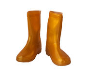 Golden-yellow rain boots on white background. Stock Photos