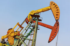 Golden yellow and red Oil pump of crude oilwell rig Royalty Free Stock Photos