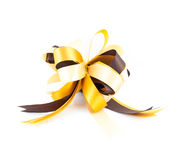 Golden or yellow ribbon bow  on white background Royalty Free Stock Photography