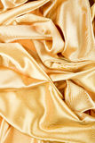Golden Yellow Satin Background. Softness Golden Yellow Textile Satin Background ( Wave Pattern Stock Images