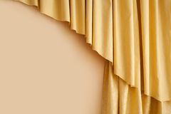 Golden yellow silk curtain in the room.  Royalty Free Stock Photo