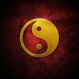 Golden ying yang Stock Image
