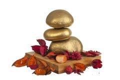 Golden zen stones Royalty Free Stock Photos
