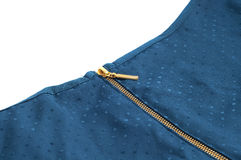 Golden zipper on a blue garment. On white background Royalty Free Stock Photos