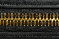 Golden Zipper Close-Up Stock Photography