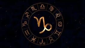 Golden zodiac horoscope spinnig wheel with Capricorn sign in center