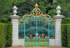 GoldenBlue Gate. A richly ornamented golden and blue gate in the gardens of an electoral palace in the Rhinevalley area of Germany Royalty Free Stock Images