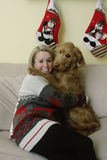 Goldendoodle Hugging Woman Stock Photography