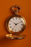 Goldene antike Uhr Lizenzfreie Stockfotografie