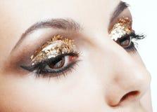 Goldene Augenverfassung Stockfotografie