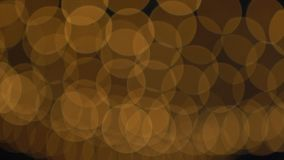 Goldene Bokeh-Lichter, die Hintergrund blinken Stockbilder