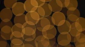 Goldene Bokeh-Lichter, die Hintergrund blinken Lizenzfreie Stockfotografie
