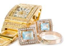 Goldene Borduhr und Schmucksachen lizenzfreies stockbild