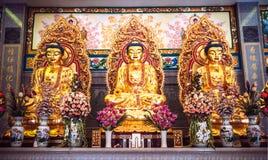 Goldene Buddha-Statuen im chinesischen Tempel Lizenzfreie Stockfotografie