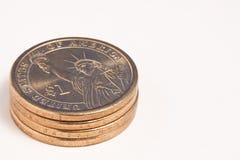 Goldene Dollar-Münzen Stockfoto