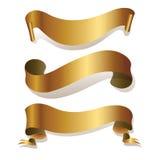 Goldene Farbbänder getrennt auf Weiß Lizenzfreies Stockfoto