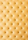 Goldene Farbsofa-Stoffbeschaffenheit Stockbilder