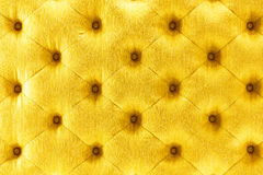 Goldene Farbsofa-Stoffbeschaffenheit Stockfoto