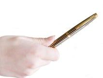 Goldene Feder in der Hand Lizenzfreie Stockfotos