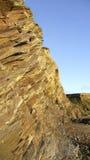 Goldene Felsen mit blauem Himmel Lizenzfreies Stockfoto