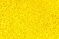 Goldene Flüssigseifeblasen als Hintergrund Stockbilder