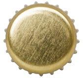 Goldene Flaschenkapsel lokalisiert auf weißem Hintergrund Stockbild