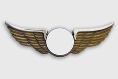 Goldene Flügel, auf weißem Hintergrund. Stockfotografie