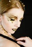 Goldene Frau stockfoto