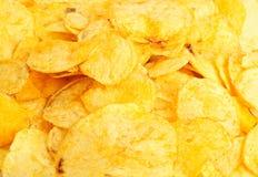 Goldene frische Chips Stockfotos