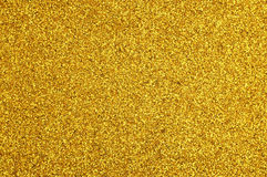 Goldene Funkelnoberfläche, als abstrakter Hintergrund Stockbild